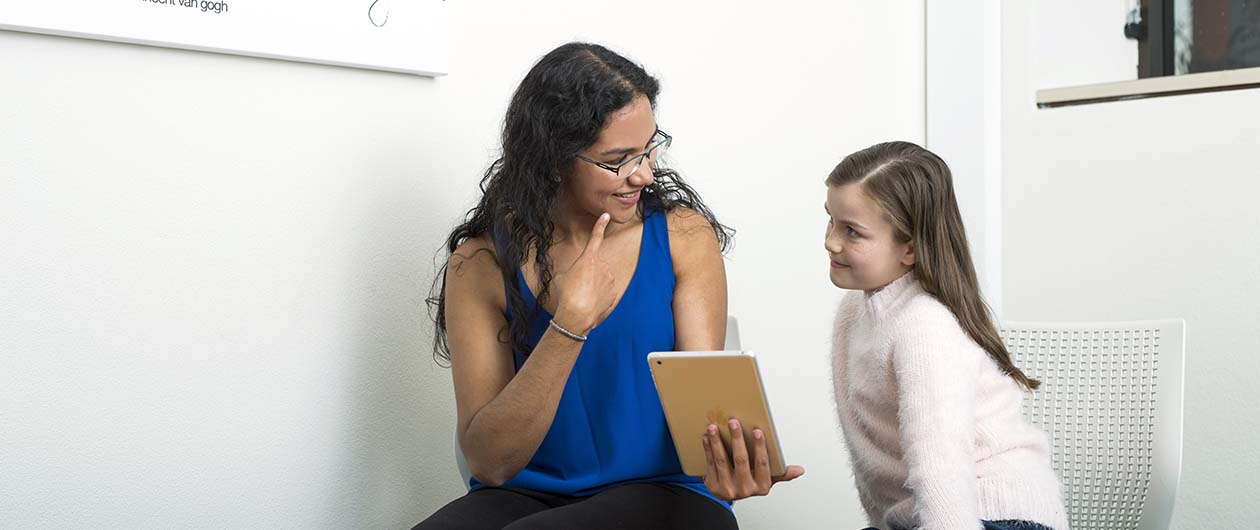 Speech Path student in consultation with child