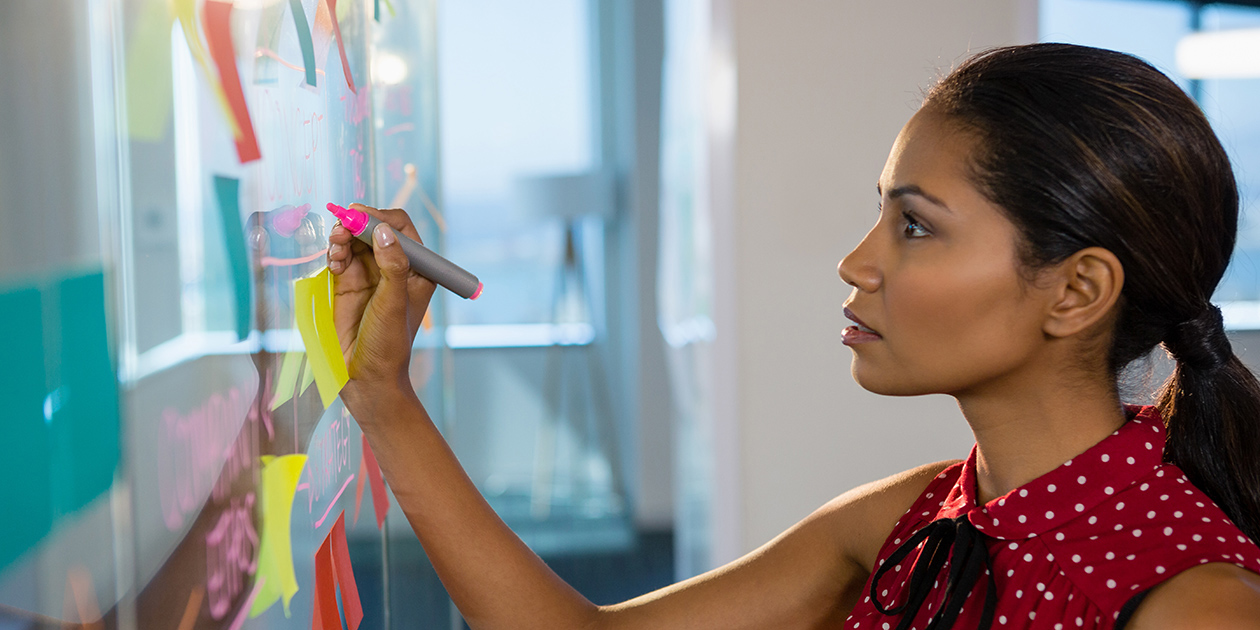 Young business woman writing on a whiteboard