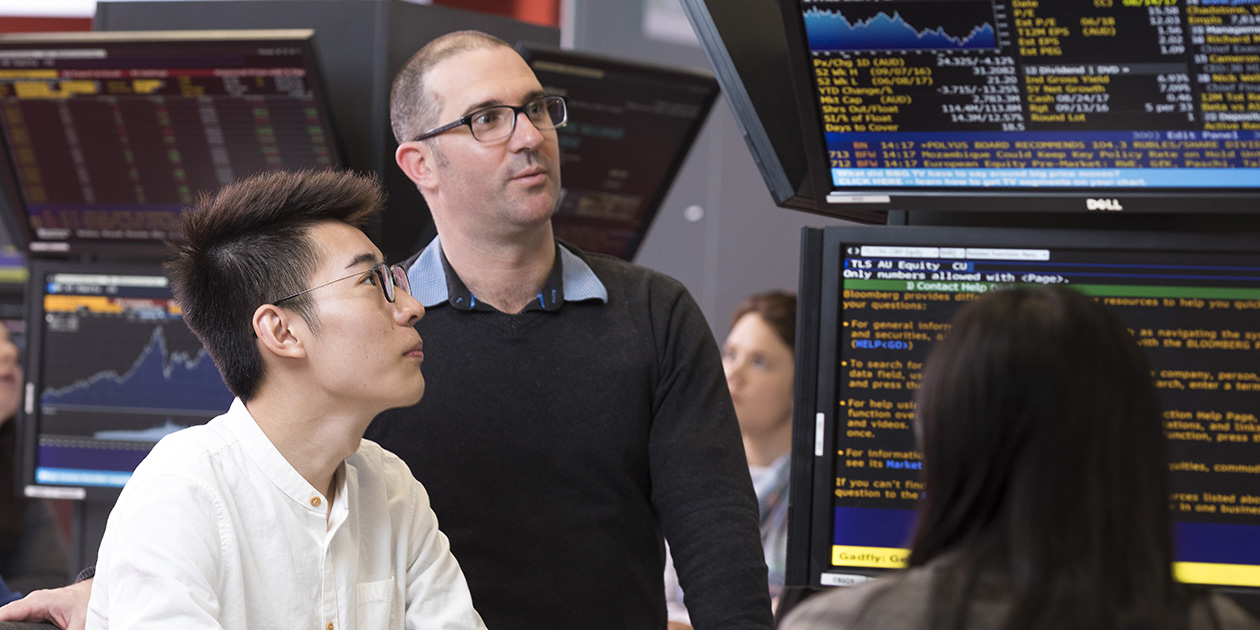 Lecturer and student in the Trading Room