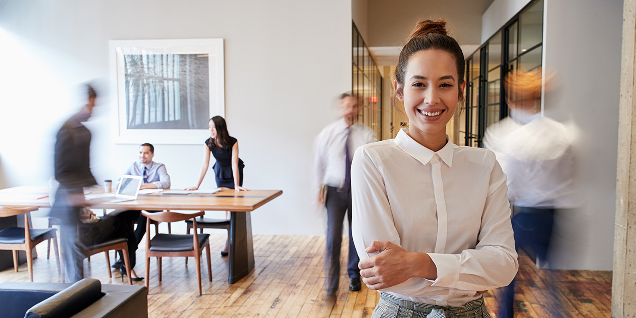 Young business woman standing in a meeting room