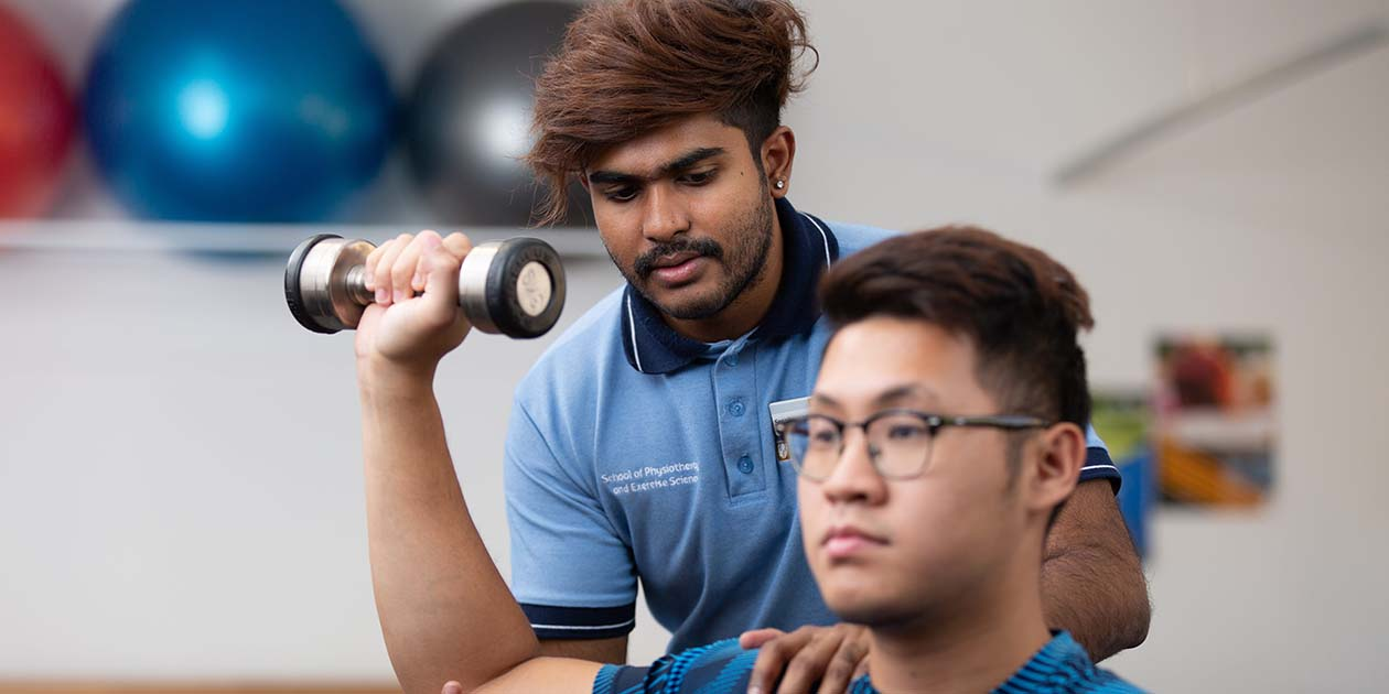 Male Physio student in learning setting