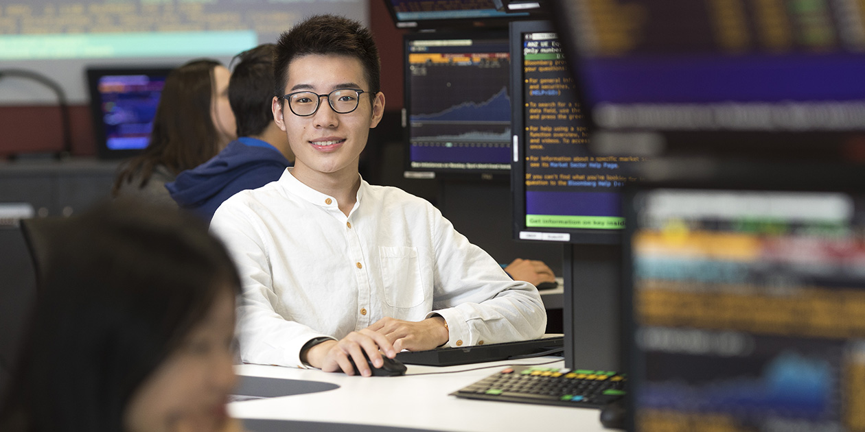Student sitting in the trading room